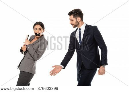 Bearded Businessman In Formal Wear Molesting Businesswoman With Scotch Tape On Mouth Isolated On Whi