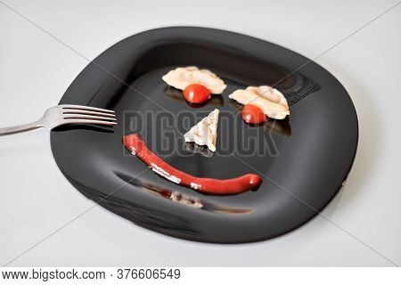 Funny Food Face, Dumpling And Ketchup. Food Art On Black Plate. Smiling Face On Plate. Motivation Fo
