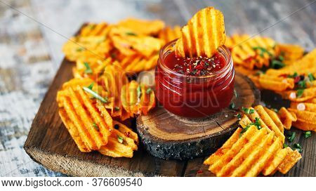 Selective Focus. Spices In Sauce And Chips. Junk Food. Chips With Sauce. Corrugated Chips. Quick Sna