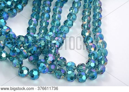 Beautiful Light Blue Glass Sparkle Crystal Isoalted Beads On White Background. Use For Diy Beaded Je