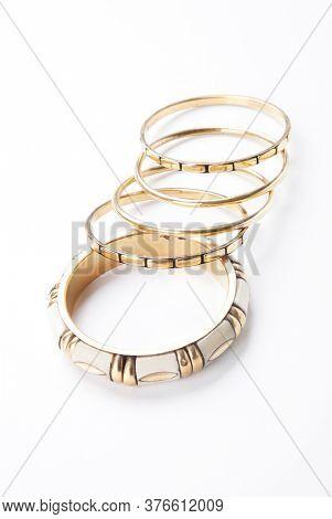 Trendy bangles over white background