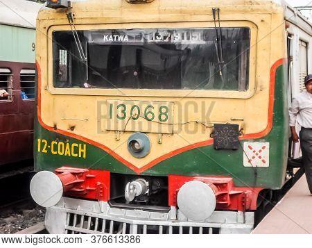 Passenger Train Stops At Katwa Junction Railway Station Platform. Katwa Is A Kolkata Suburban Railwa