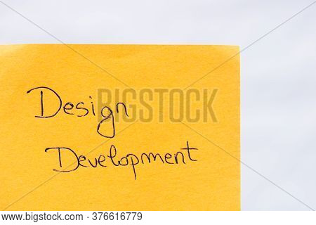 Design Development Handwriting Text Close Up Isolated On Orange Paper With Copy Space. Writing Text