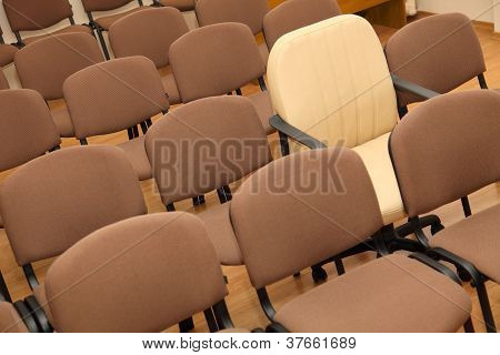 Manager Chair Among Ordinary Chairs
