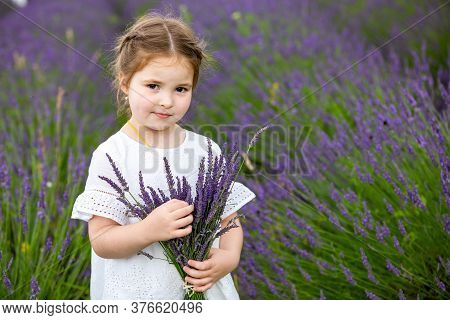 Smiling Young Girl In White Dress In A Lavender Field In Czech Republic