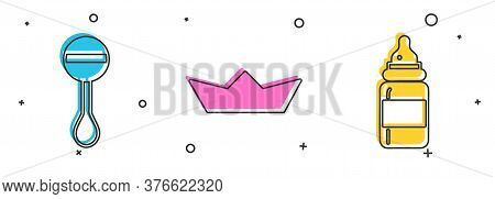 Set Rattle Baby Toy, Folded Paper Boat And Baby Bottle Icon. Vector