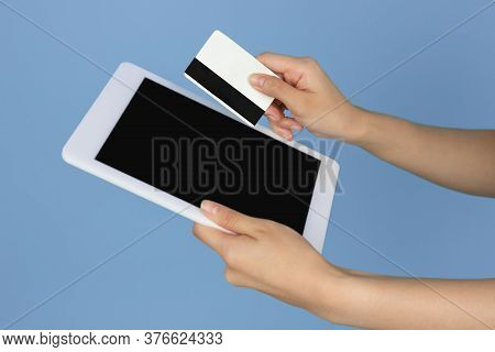 Female Hands With Debit, Credit Card And Tablet With Copyspace On Blank Screen. Online Shopping Conc