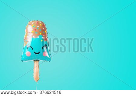 Popsicle Shaped Balloon On A Turquoise Background With Copy Space. Postcard With Ice Cream.