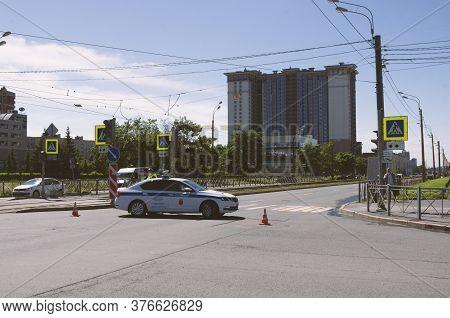 Saint Petersburg, Russia - June 12, 2020: Police Car Blocks The Passage On The Street Near Road Cops