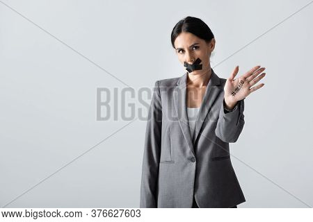 Businesswoman With Scotch Tape On Mouth Showing Hand With Me Too Lettering Isolated On White, Gender
