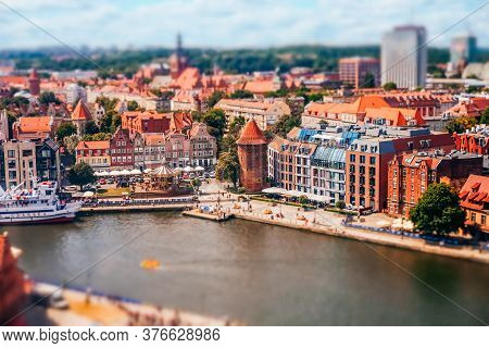 Gdansk, Poland - July 5, 2019: Tilt-shift Effect Applied View Of Motlawa River And Old Town Of Gdans