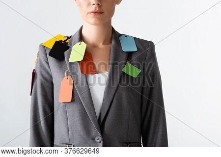 Cropped View Of Businesswoman With Labels On Suit Standing Isolated On White, Gender Inequality Conc