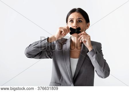 Emotional Businesswoman Touching Scotch Tape On Mouth Isolated On White, Gender Inequality Concept