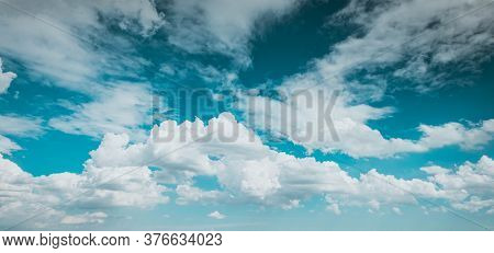 Blue Sky White Fluffy Clouds Background . Beautiful Blue Sky And White Cumulus Clouds Abstract Backg