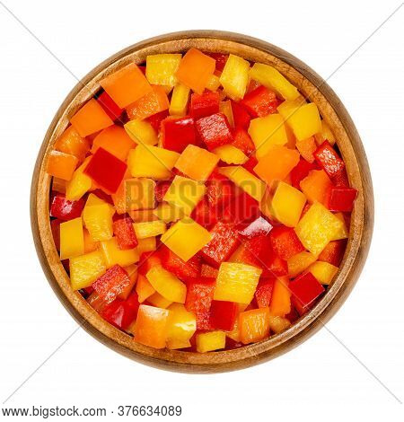 Diced Bell Peppers In A Wooden Bowl. Sweet Pepper, Capsicum Or Also Called Paprika, Cut In Colorful