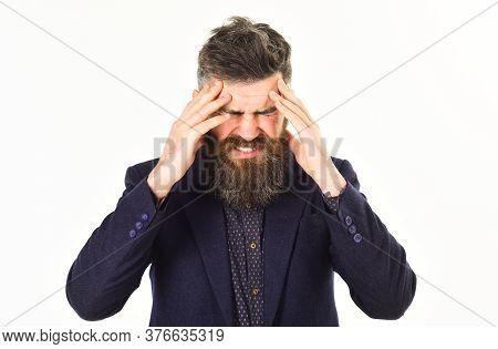 Headache And Stress Concept. Businessman Suffers From Headache