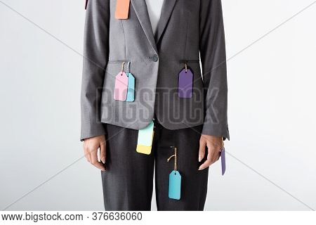 Cropped View Of Businesswoman With Labels On Formal Wear Standing Isolated On White, Gender Inequali