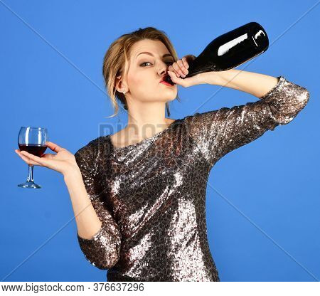 Winetasting Concept. Girl With Tricky Face Drinks Expensive Cabernet