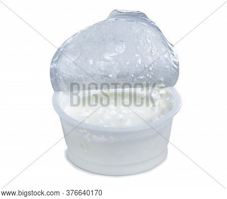 Granular Cottage Cheese In Cream On White Background Isolation