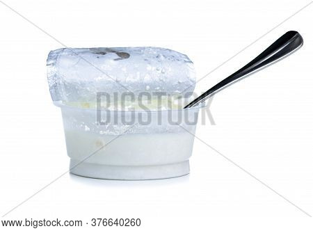 Granular Cottage Cheese In Cream With Spoon On White Background Isolation