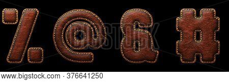 Set of symbols percent, at, ampersand, hash made of leather. 3D render font with skin texture isolated on black background. 3d rendering
