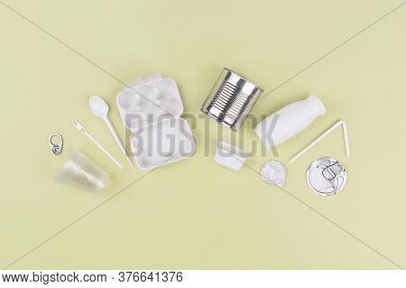 Food Plastic, Metal, Cardboard Packaging On Green Background. Concept Of Recycling Plastic And Ecolo