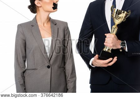 Partial View Of Businessman Holding Golden Trophy Near Businesswoman With Duct Tape On Mouth And Med