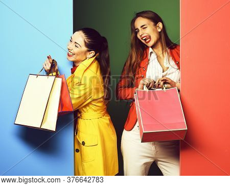 Funny Smiling Girls With Pegs On Green Blue Studio Background