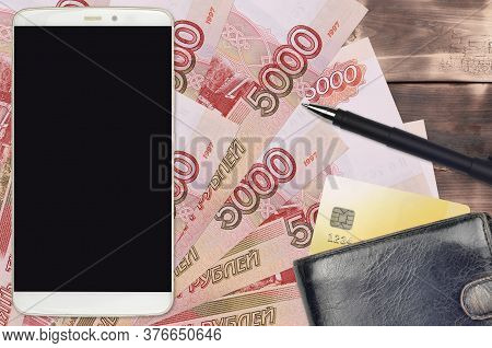 5000 Russian Rubles Bills And Smartphone With Purse And Credit Card. E-payments Or E-commerce Concep