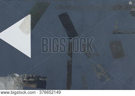 Adhesive Tape Stains And Stickers On Weathered Metal Surface. Abstract Grunge Background With Copy-s