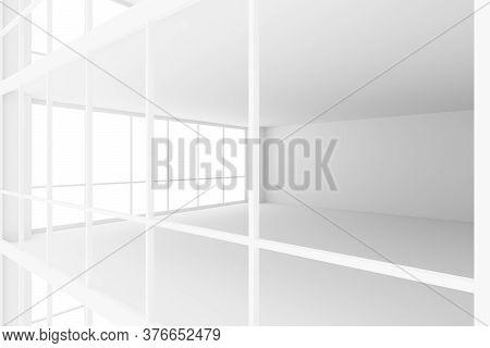 Empty White Business Office Room With White Floor, Ceiling And Walls And Light From Large Windows An