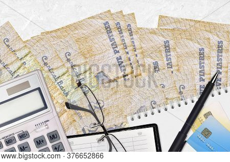 25 Egyptian Piastres Bills And Calculator With Glasses And Pen. Tax Payment Concept Or Investment So