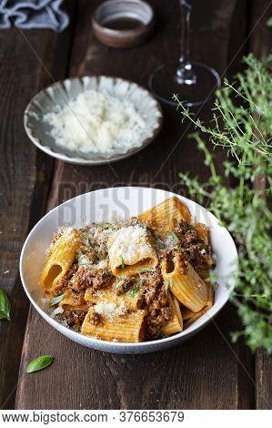 Rigatoni Pasta With Ragu Bolognese Sauce, Parmesan And Basil