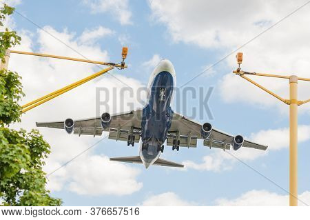 large passenger jet on landing approach to an airport with its undercarriage down