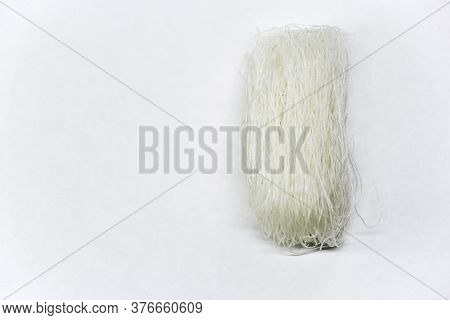 A Bunch Of Raw Chinese Cellophane Noodles Or Glass Noodles. Crystal Noodles On A White Background Co