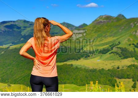 woman looking at the view of beautiful landscape in France, Cantal