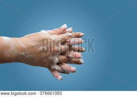 Closeup Of Female Hand Hygiene With Soap And Interlaced Fingers