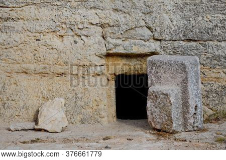 The Cave Is A Coffin For Burial According To The Ancient Jewish Tradition. Large Stone At The Entran