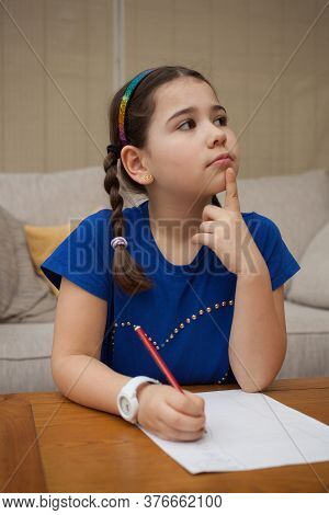 A Girl At Home Doing Sums In Her Head, Taken 17th February 2020 In Wool, Dorset In The Uk