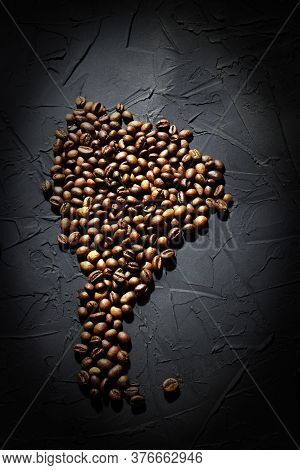 Roasted Coffee Beans, Coffee From Brazil, Scattered In The Shape Of The Mainland Of South America, O