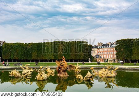 Versailles, France - August 27, 2019 : Dragon Fountain In Beautiful Gardens Of Famous Versailles Pal