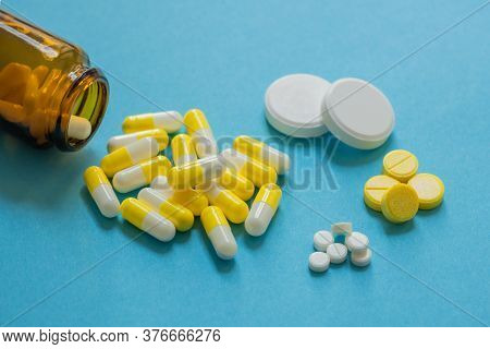 Medicines On A Blue Background, Different Types Of Medicines, Soluble Tablets, Medicinal Powder In A
