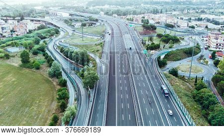 Aerial View Of Highway In City. Cars Crossing Interchange Overpass. Highway Interchange With Traffic