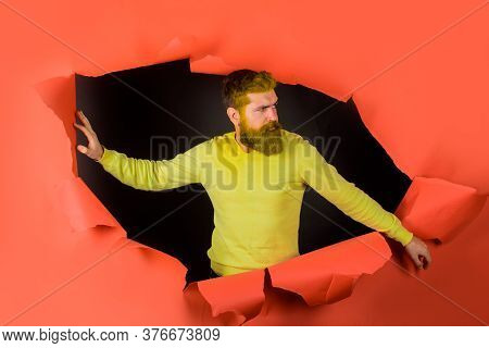 Advertising. Sales. Bearded Man Through Paper. Copy Space For Advertising. Man Looking Through Hole