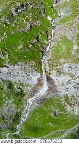 Aerial View Of Scenic High Waterfall On The Italian Alps. Tourism Destination Hiking Outdoors Activi