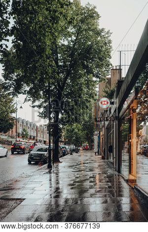 London, Uk - July 02, 2020: View Of A Row Of Shops On An Empty Hampstead High Street In The Rain. Ha
