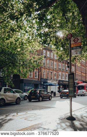 London, Uk - July 02, 2020: Cars Queue In Traffic On Hampstead High Street In The Rain, Selective Fo