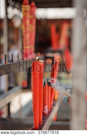 Lit Red Candles At A Buddhist Temple