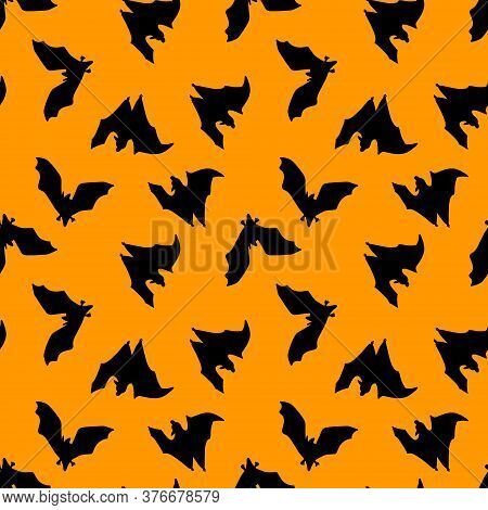 Seamless Pattern Of Bats.silhouette Of Black Bats On An Orange Background. Design For Halloween.flat