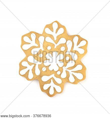 Christmas Gingerbread In The Shape Of A Snowflake, Isolated On A White Background. Gingerbread Cover